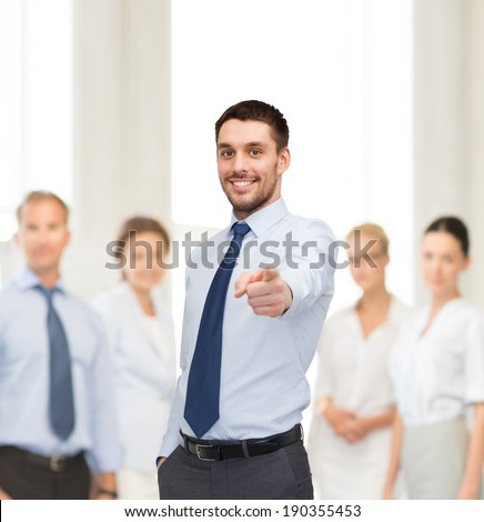 business, gesture and office concept - handsome businessman pointing finger at you - stock photo