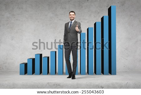business, gesture and office concept - handsome businessman showing thumbs up with growing chart on the back - stock photo