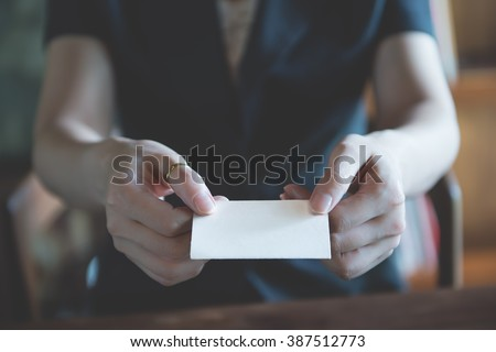 business girl  showing an empty business card with two hand, closeup shot vintage color tone style /  contact me  - stock photo