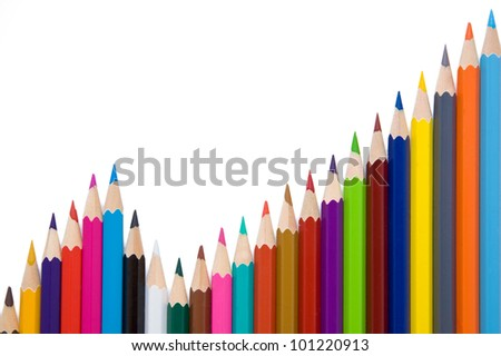 Business graph illustrating growth made up of colored pencils, isolated on white background - stock photo