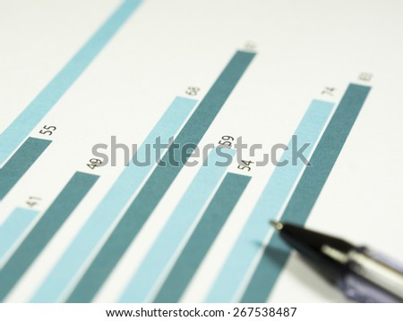 Business graphs and charts on the paper.  - stock photo