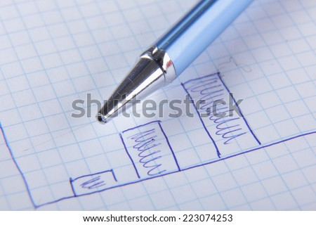 Business graphs with the pen - stock photo