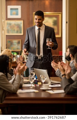 business group applauding during corporate meeting - stock photo