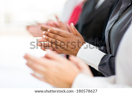 business group applauding for good news - stock photo