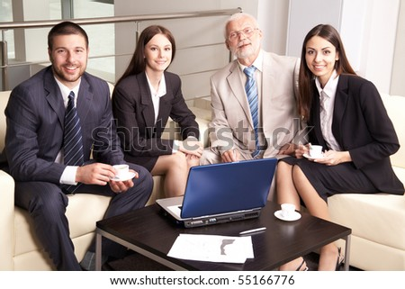 Business group meeting portrait - four business people working together. - stock photo