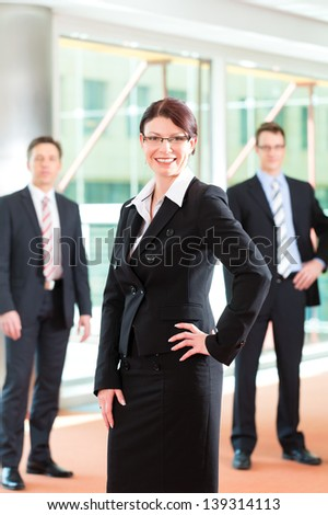 Business - group of businesspeople posing for group photo in office - stock photo
