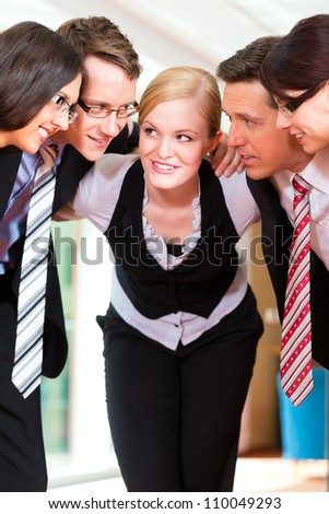 Business - group of businesspeople standing in office, they seem to be a very good team, business metaphor - stock photo