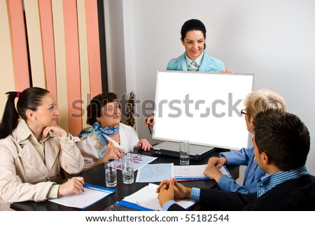 Business group of people having a meeting and a woman making a presentation  with speech on blank board,copy space for text message on placard - stock photo