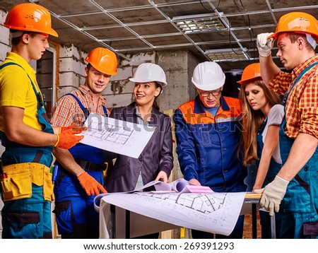 Business group people in builder helmet indoor. - stock photo
