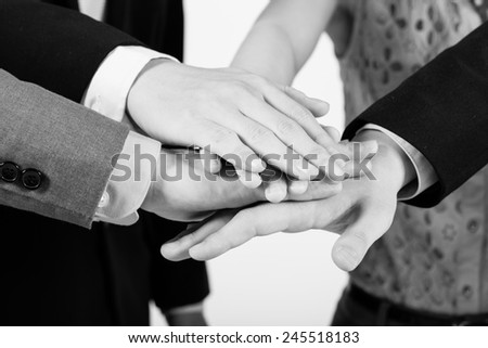 Business group with hands together - teamwork concepts - stock photo