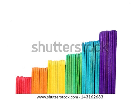 Business growth graph by ice cream stick on white background - stock photo