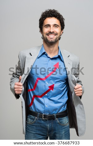 Business growth graphs on a businessman's shirt - stock photo