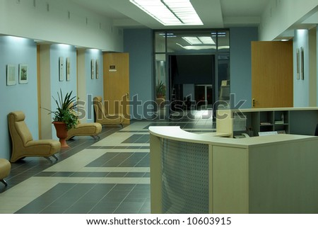 business hall interior with counter doors and armchairs - stock photo