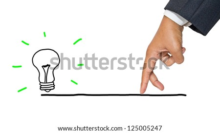 Business hand as finger walking to the light bulb - stock photo