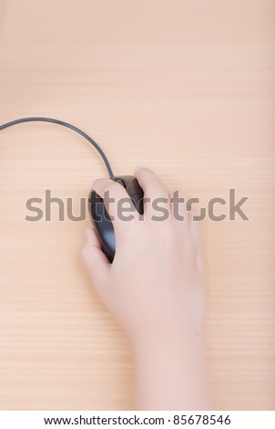 Business hand click mouse on wood. - stock photo