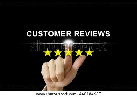 business hand clicking customer reviews with five stars on screen - stock photo