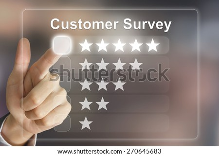 business hand clicking customer survey on virtual screen interface - stock photo