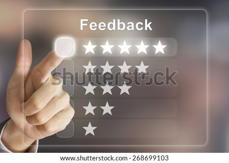business hand clicking feedback on virtual screen interface - stock photo