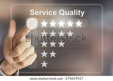 business hand clicking service quality on virtual screen interface - stock photo