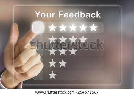 business hand clicking your feedback on virtual screen interface - stock photo