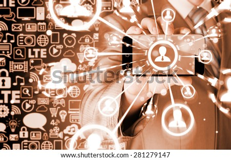 Business Hand holding a phone show the social network - stock photo