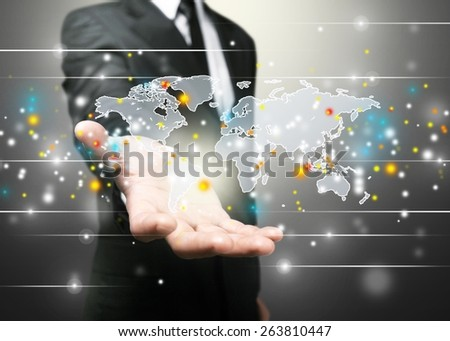 Business. Hand holding world map - stock photo