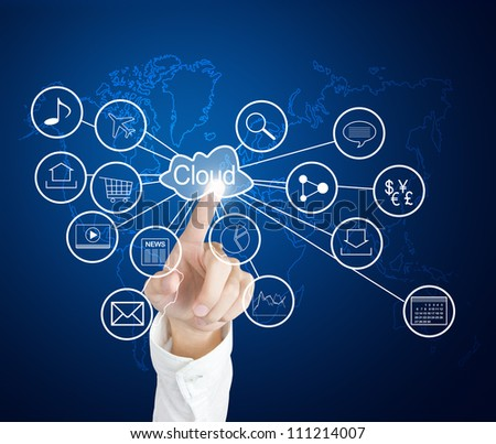 business hand pointing at cloud computing and connected world wide application network - stock photo