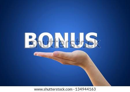 Business hand pointing bonus concept - stock photo