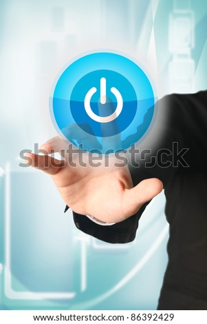 business hand press power button on touch screen - stock photo