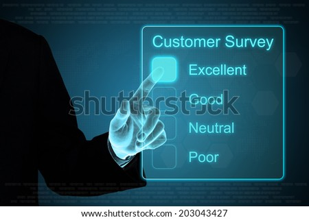 business hand pushing customer survey on a touch screen interface  - stock photo