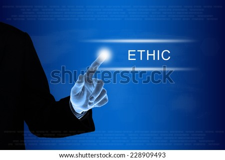 business hand pushing ethic button on a touch screen interface  - stock photo