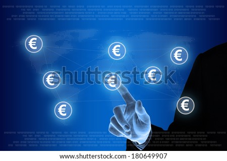 business hand pushing euro currency on networking concept - stock photo