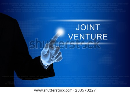 business hand pushing joint venture button on a touch screen interface  - stock photo