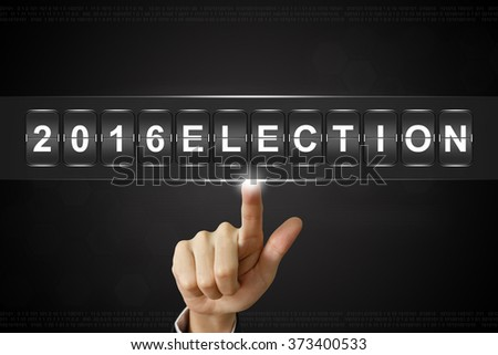 business hand pushing 2016 presidential election on Flipboard Display - stock photo