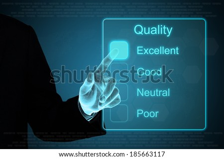 business hand pushing quality feedback on a touch screen interface  - stock photo