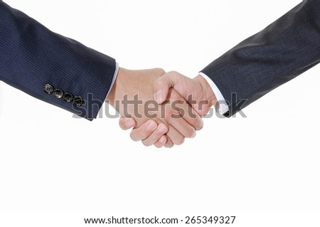 Business hand shaking hands between two colleagues  - stock photo
