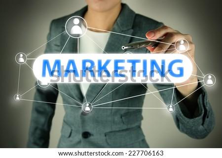 Business hand touching  Marketing words - stock photo