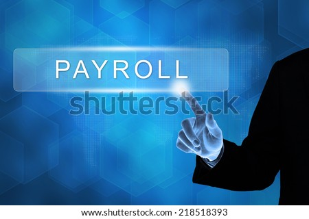 business hand touching payroll button on a touch screen interface  - stock photo