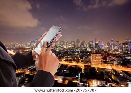 Business hand touching screen on mobile - stock photo