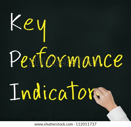 business hand writing key performance indicator ( KPI ) concept on chalkboard - stock photo