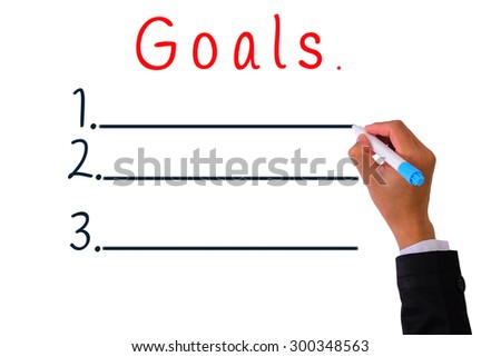 Business Hand writing with pen marker goals to attain. - stock photo