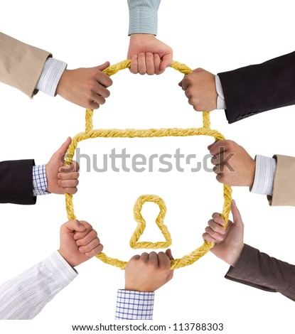 Business hands holding golden rope forming lock - stock photo