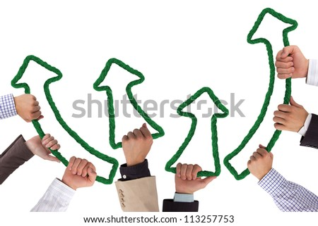 Business hands holding green arrows pointing upwards - stock photo