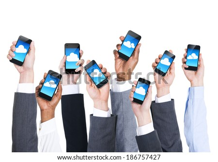 Business Hands Holding Phones With Clouds - stock photo