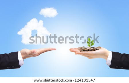 business Hands with money and house from clouds on blue sky background, concept for family and Estate concept - stock photo