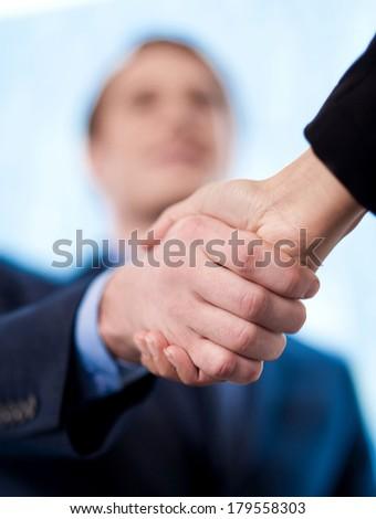 Business handshake among two corporates - stock photo