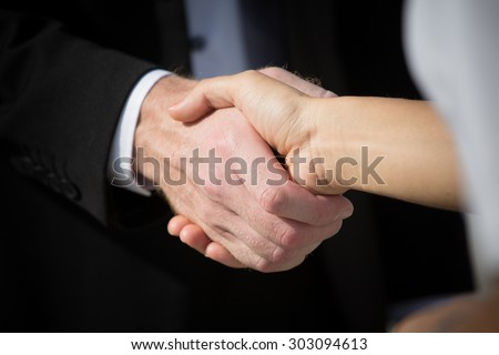 Business handshake and business people. Business handshake for closing the deal after singing the lucrative contract between companies. - stock photo