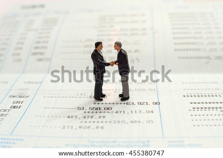 Business handshake and business people, miniature people business man concept - stock photo