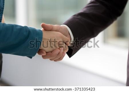 business handshake business partners - stock photo