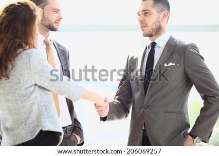 Business handshake. Business people shaking hands, finishing up meeting - stock photo